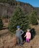 Liliana and Madison in front of the tree we picked out