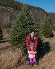 Melissa and Madison in front of the tree we picked out