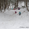 """2021.02.07<br> Madison sliding down the hill while sledding at a friend's house<br> <a href=""""https://www.adamclarkmedia.com/People/Our-Family/Sledding-2721/"""">Full gallery</a>"""