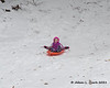 While Liliana was getting ready, Madison just sat down on one of the sleds and went down the hill on her own without anyone getting her aimed in the right direction