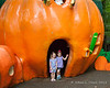 Liliana and Autumn standing at the doorway of a giant pumpkin