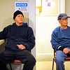 Matthew Martinez, 35, (left) and John Kelley, 44, watch television in the warmth of Our Father's House on Lunenburg St. in Fitchburg on a cold Friday night.<br /> SENTINEL & ENTERPRISE / BRETT CRAWFORD
