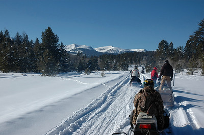 Ed Johnson of the Utah Division of Wildlife Resources snow mobiling to high Uintas for a fishing trip.  By Ron Stewart. 1-19-07