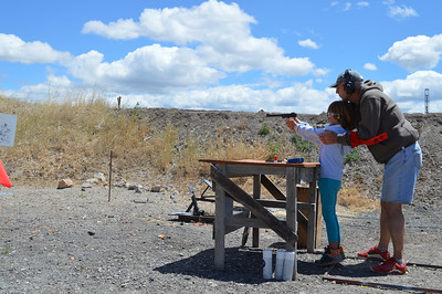 A young girl practicing her shooting skills at 2014 Outdoor Adventure Days. Photo by Crystal Ross, Utah Division of Wildlife Resources.