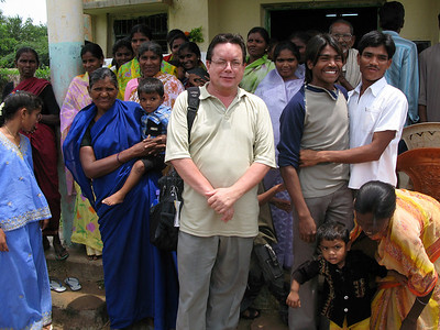 Fr. Jack Kurps (USA) poses with villagers.
