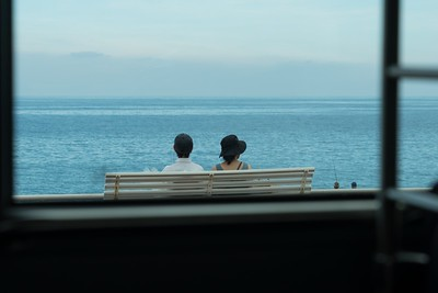 Couple - taken from moving bus in Nice May 2018