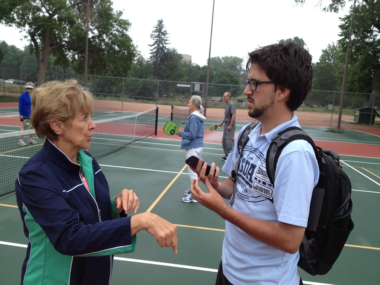 A young reporter from the Gazette interviewing State Games medalists.
