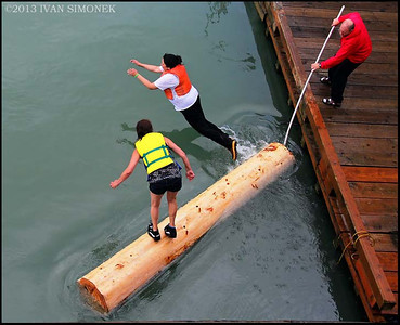 """ALASKANS AT PLAY1"",July 4th,log rolling,Wrangell,Alaska,USA."