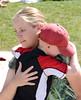Nathan Falcone, 9, gives Amy Ruhf a hug.