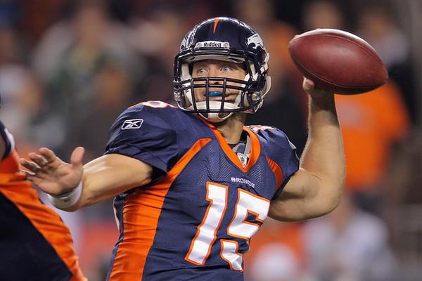 DENVER, CO - NOVEMBER 17:  Tim Tebow #15 of the Denver Broncos throws a pass in the first quarter against the New York Jets at Invesco Field at Mile High on November 17, 2011 in Denver, Colorado.  (Photo by Doug Pensinger/Getty Images)