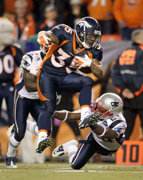 DENVER, CO - DECEMBER 18: Lance Ball #35 of the Denver Broncos tries to hurdle the tackle of Nate Jones #23 of the New England Patriots on December 18, 2011 during the second half at Sports Authority Field at Mile High in Denver, Colorado. The New England Patriots won the game 41-23. (Photo by Marc Piscotty/Getty Images)