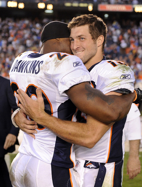 SAN DIEGO, CA - NOVEMBER 27:   Tim Tebow #15 and  Brian Dawkins #20 of the Denver Broncos celebrate a 16-13 overtime win over the San Diego Chargers at Qualcomm Stadium on November 27, 2011 in San Diego, California.  (Photo by Harry How/Getty Images)