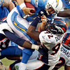 San Diego Chargers quarterback Philip Rivers is sacked by Denver Broncos defensive end Elvis Dumervil during the second half of an NFL football game  on Sunday, Nov. 27, 2011, in San Diego. (AP Photo/Lenny Ignelzi)