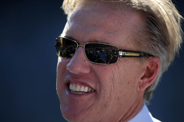 SAN DIEGO, CA - NOVEMBER 27:  Hall of Fame Quarterback John Elway of the Denver Broncos looks on from the field against the San Diego Chargers during their NFL Game on November 27, 2011 at Qualcomm Stadium in San Diego, California  (Photo by Donald Miralle/Getty Images)