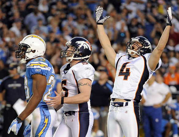 SAN DIEGO, CA - NOVEMBER 27:   Matt Prater #5 and Britton Colquitt #4 of the Denver Broncos celebrate a filed goal for a 16-13 win in front of  Quentin Jammer #23 of the San Diego Chargers during overtime at Qualcomm Stadium on November 27, 2011 in San Diego, California.  (Photo by Harry How/Getty Images)