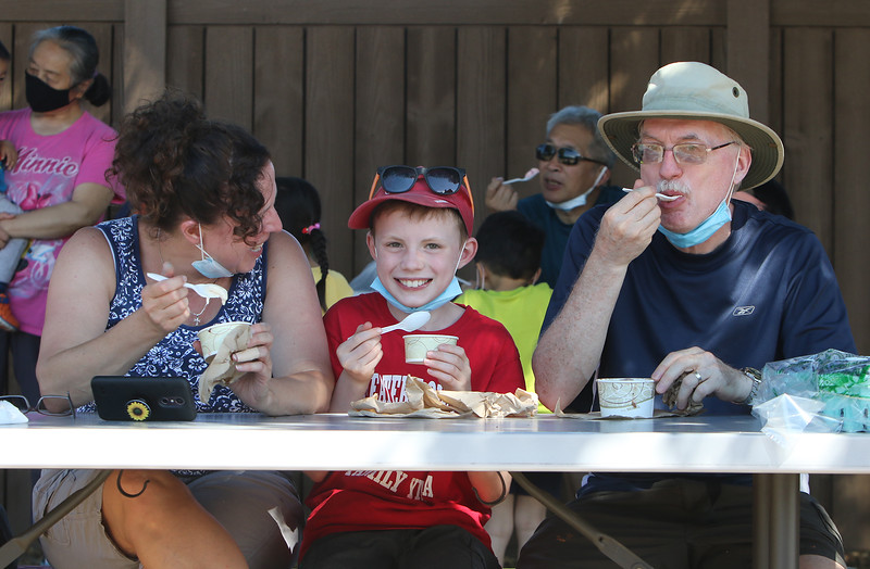 Features at Parlee Farms in Tyngsboro. Barbara and husband Dave Brown of Lowell, and son Jonathan, 9, enjoy ice cream. (SUN/Julia Malakie)