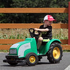 Samuel Mello, 4-1/2, of Andover, rides a miniature tractor in the 'tractor training' area at Parlee Farms in Tyngsboro. (SUN/Julia Malakie)