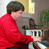 Pastor PJ O'Connor of the Village Church at 75 Sawyer Street in Lancaster shows off his singing talent as he plays the piano in the church. SENTINEL & ENTERPRISE/JOHN LOVE