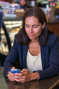Stock Photo of Woman using Mobile Phone inside Cafe (Model Released)