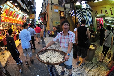 Selling Portuguese tarts, Macau