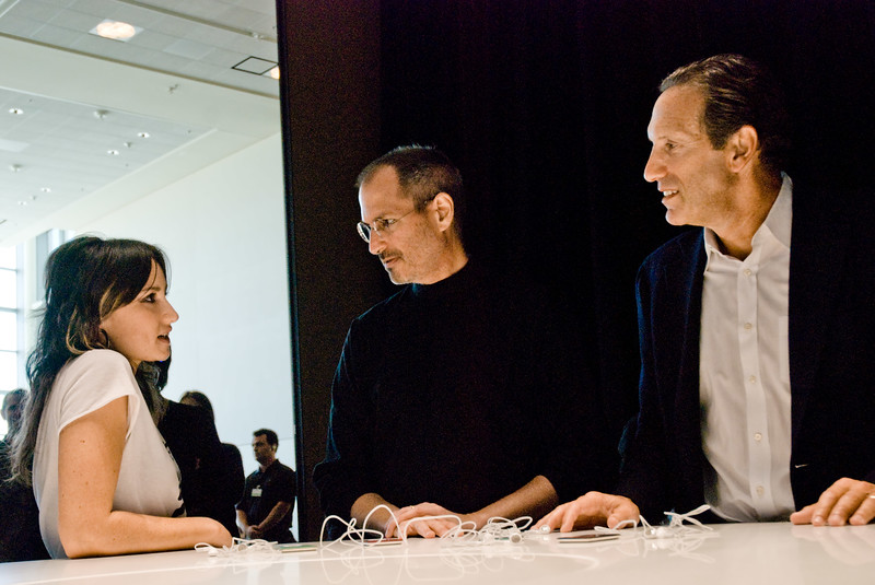 """So how come my iPod earbuds always fall out when I go jogging?"" Singer K.T. Tunstall with Apple CEO Steve Jobs, and Starbucks CEO Howard Schultz at the Moscone Center in San Francisco."