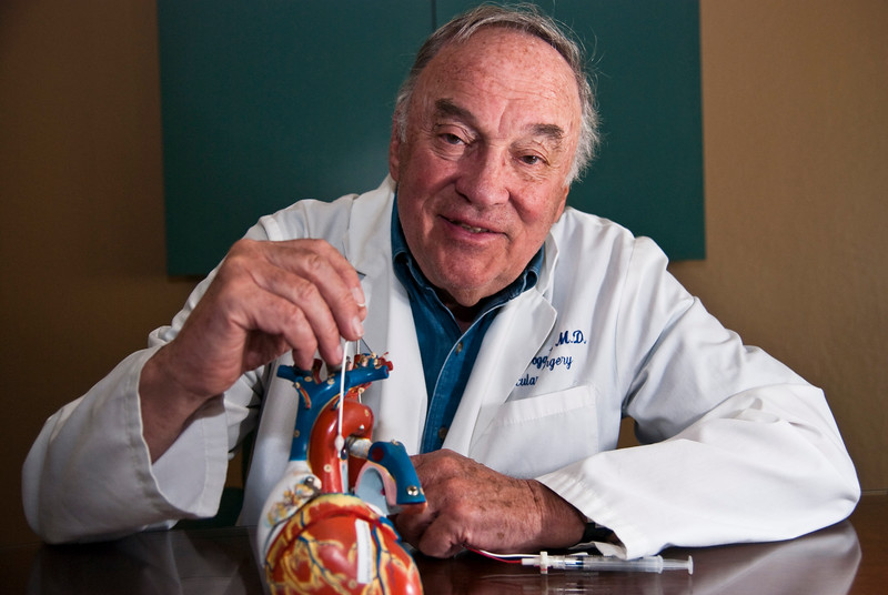 Dr. Thomas Fogarty, inventor of the balloon catheter, with a model of the human heart.