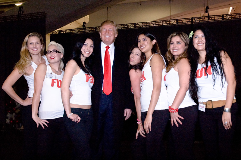 "Real estate tycoon Donald Trump posing at San Francisco's Moscone Center with ""Fun Girls"" at the ""Real Estate & Wealth Expo""."