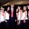 """Real estate tycoon Donald Trump posing at San Francisco's Moscone Center with """"Fun Girls"""" at the """"Real Estate & Wealth Expo""""."""