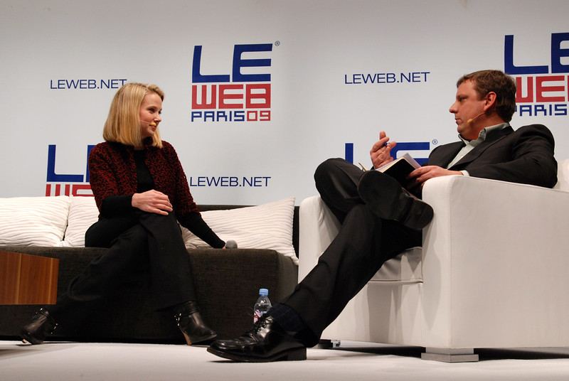 Google manager Marissa Mayer chatting with Techcrunch founder Michael Arrington at the Le Web conference in Paris.