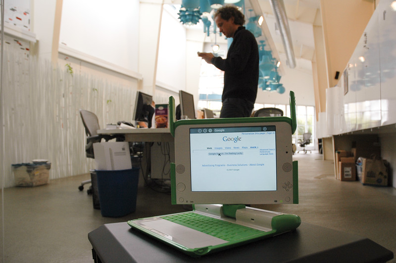 "The ""XO Laptop"", also known as the $100 laptop, and its designer Yves Béhar at Béhar's design agency Fuseproject in San Francisco."