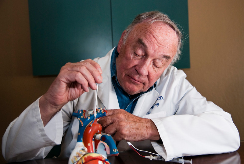 Dr. Thomas Fogarty demonstrating the balloon catheter he invented in 1963 for minimally invasive heart surgery.