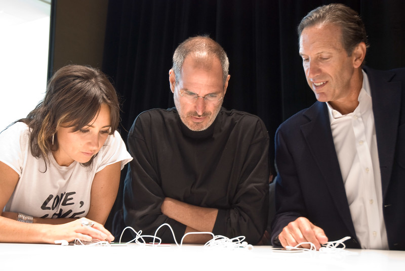 Singer K.T. Tunstall, Apple CEO Steve Jobs and Starbucks CEO Howard Schultz admire Apple's newest collection of iPods at the Moscone Center in San Francisco.