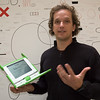 "Yves Béhar with the ""XO Laptop"" at his design agency Fuseproject in San Francisco."