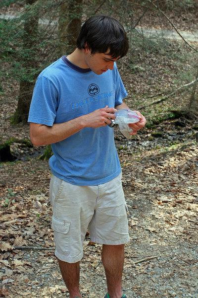 Grosse inspecting a salamander