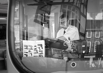 Bus Driver with Book - York North Yorkshire UK 2012
