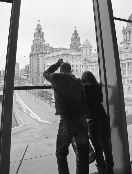Liverpool Couple - Looking Out Of Building Liverpool Merseyside UK 2011