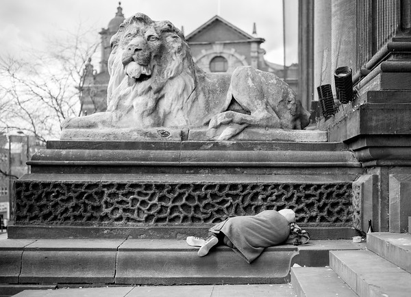 Man Asleep near Lion - Leeds West Yorkshire UK 2017