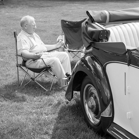 Man Sat Near Classic Car - Harewood Leeds West Yorkshire UK 2017