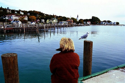 Nancy with feathered friend at the harbor at Mackinac Island