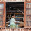 Woman in a Silk Factory Window