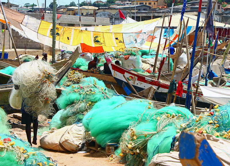 Fisherman Covered with HIs Nets