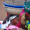 Woman With Baskets On Her Head
