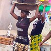 Women Carrying Pans On Their Head