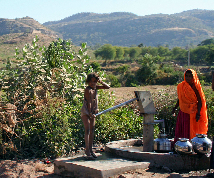 Girl & Mother Pumping Water