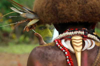 Papua New Guinea Warrior Putting on Makeup