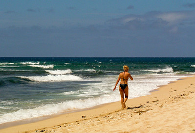 Girl in a bikini, Sunset Beach, North Shore of O'ahu, Hawai'i