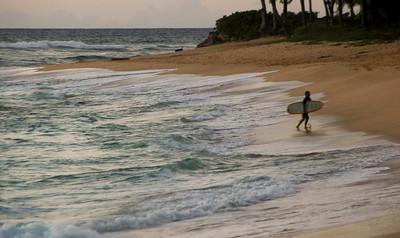 Surfer, Sunset Beach, North Shore of O'ahu, Hawai'i