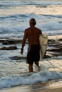 Surfer at sunset Sunset Beach, North Shore of O'ahu, Hawai'i