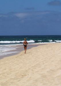 Girl in a bikini, Sunset Beach, North Shore of O'ahu, Hawai'i