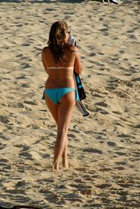 Pretty girl walking along the beach  Sunset Beach, North Shore of O'ahu, Hawai'i
